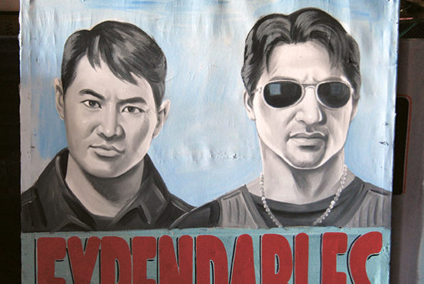 A hand-painted movie billboard of The Expendables