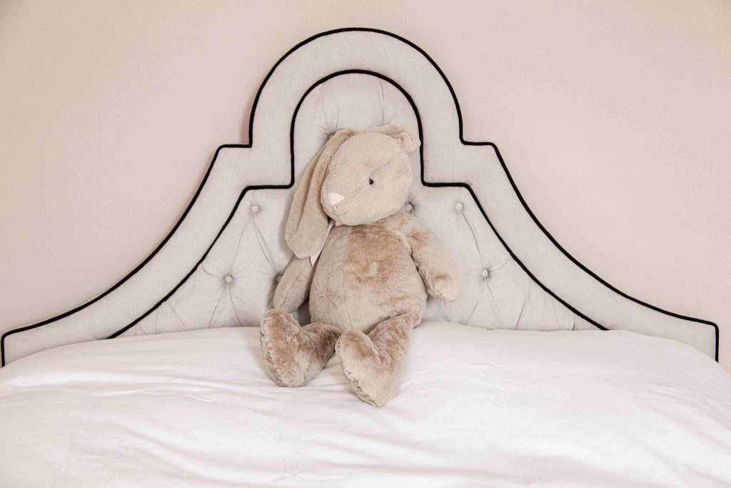 The minimalist look and neutral colors are also evident in the children's bedroom.