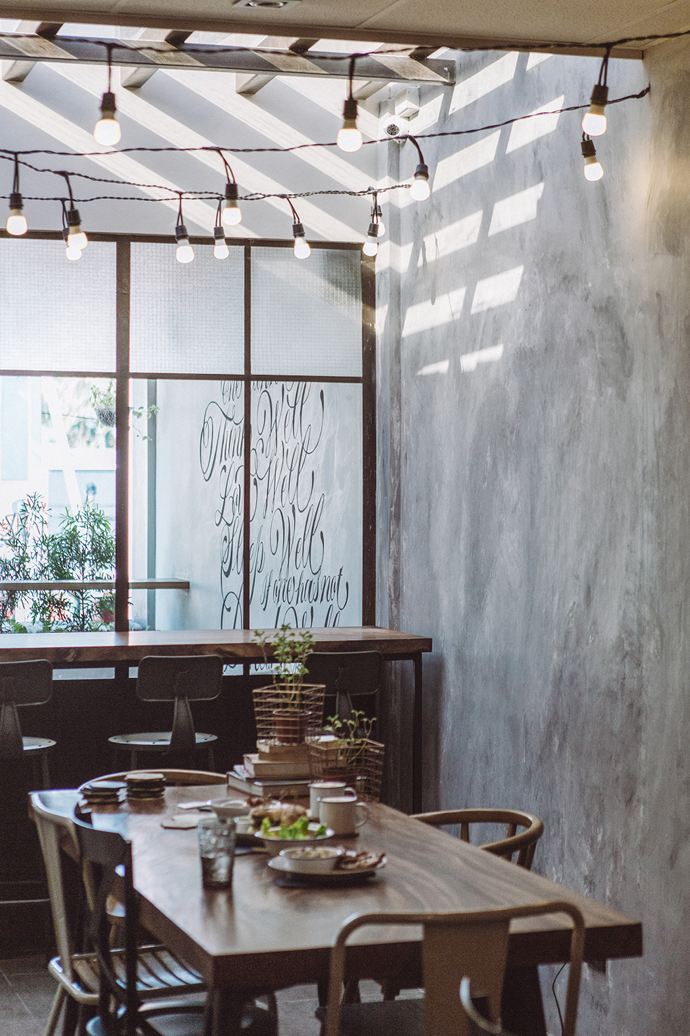 Industrial interiors of Spoon Eat + Drink, softened by the elevated sunroof