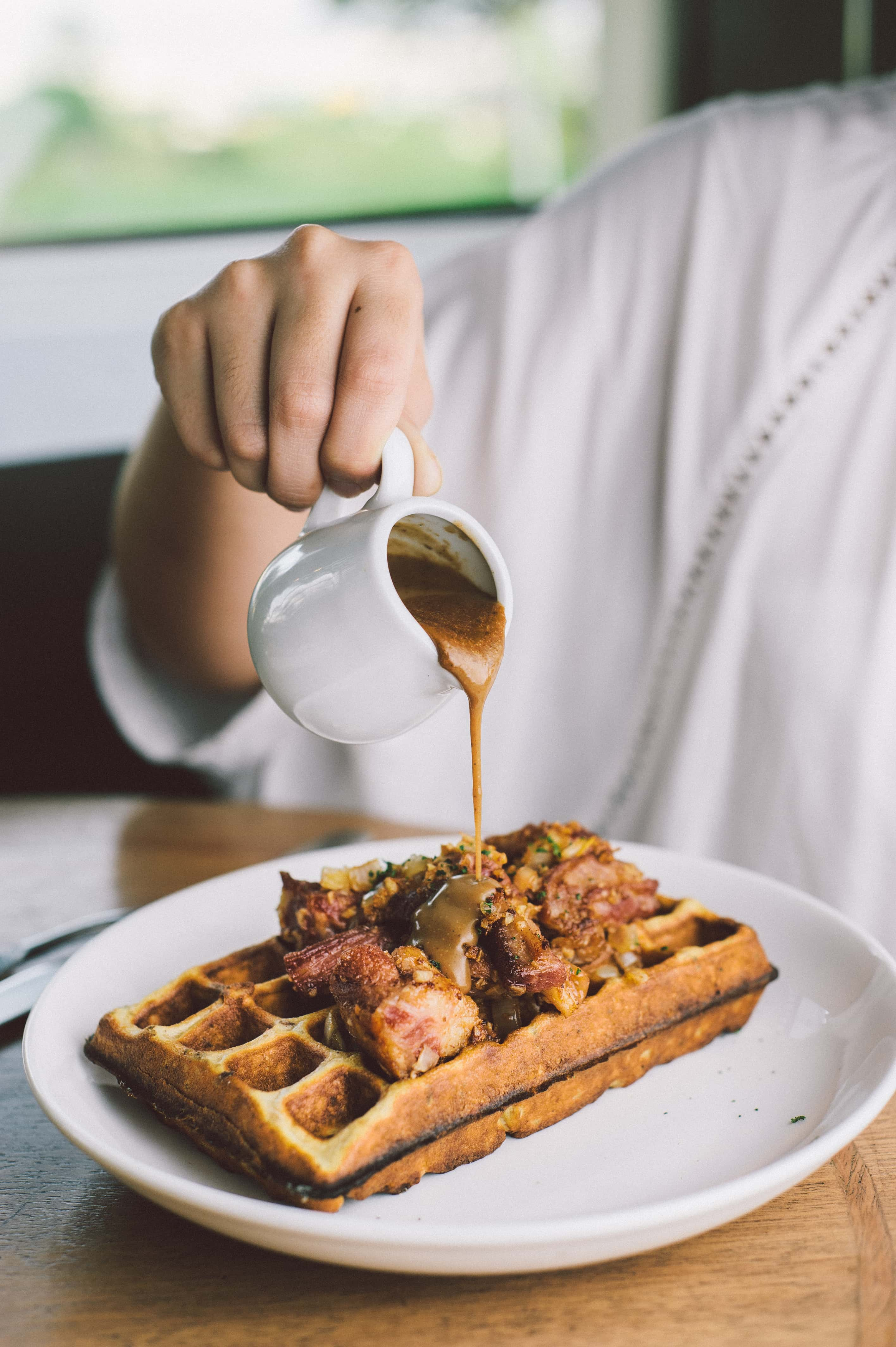 Porridge waffles with home-cured beef and peppercorn gravy