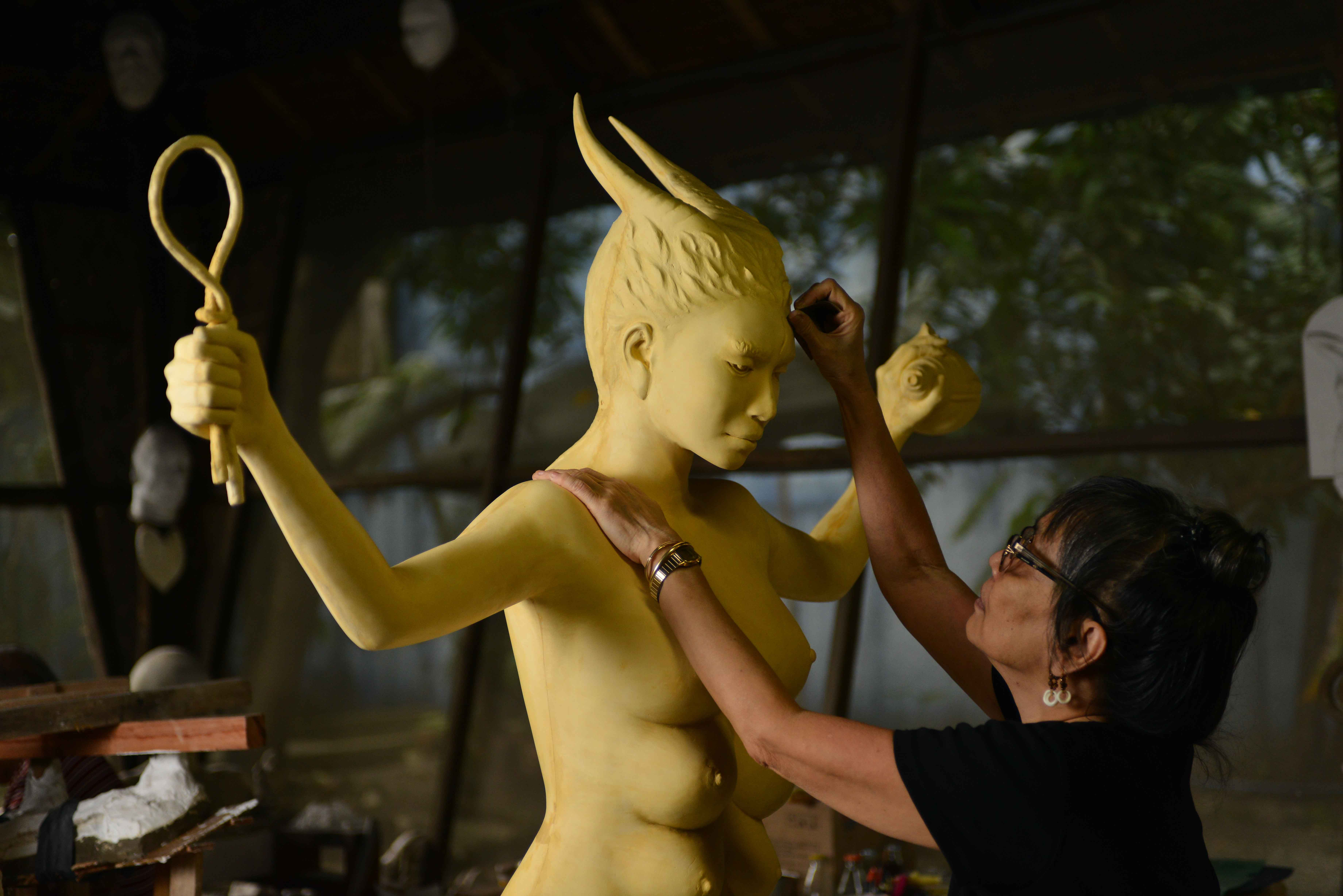 Agnes Arellano working on her Goddesses piece. Photo from Art Fair Philippines.
