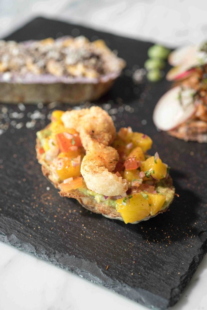 Guacamole with mango salsa and fish