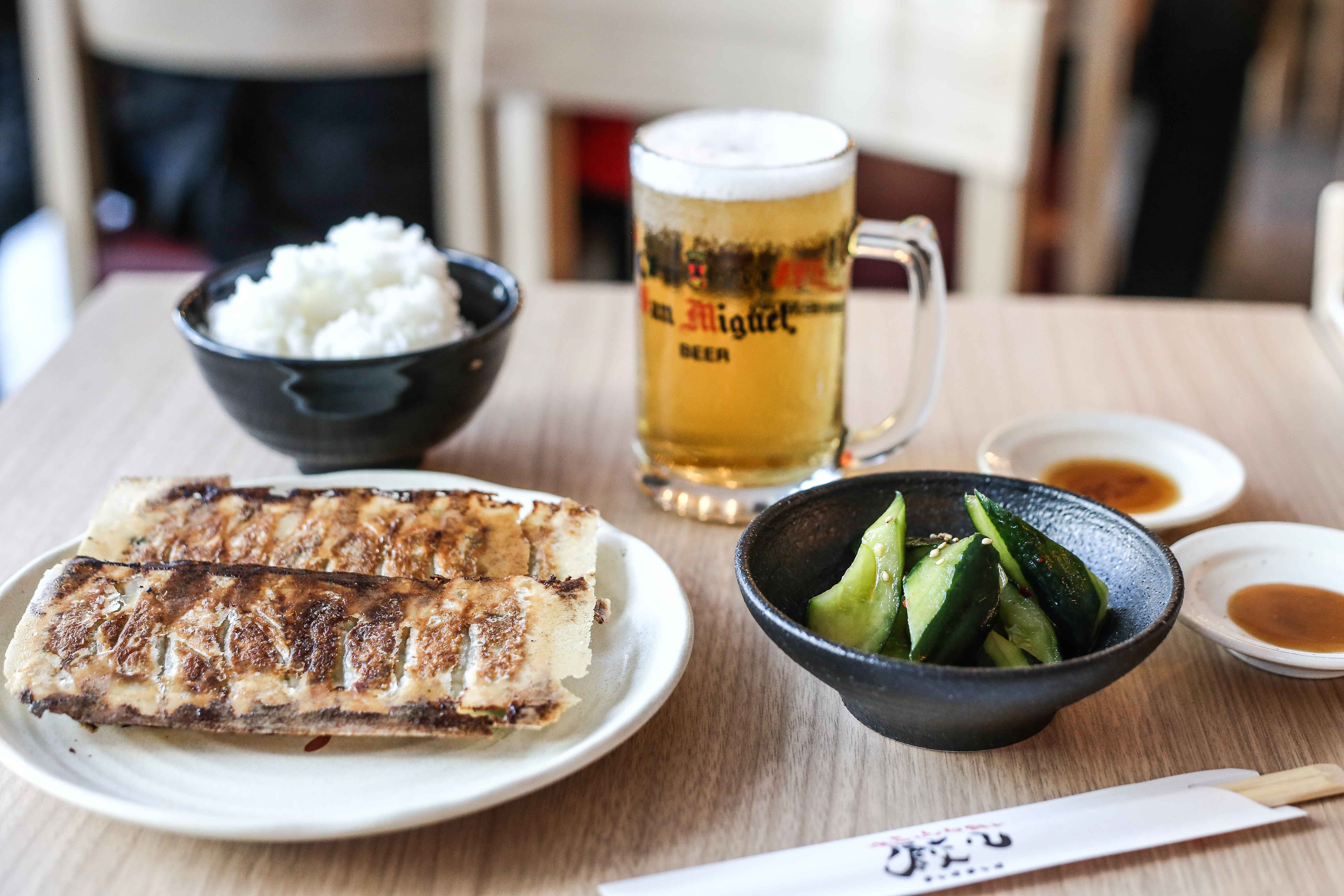 The Chao Chao Gyoza set comes with rice, a glass of beer, and your choice of sides.