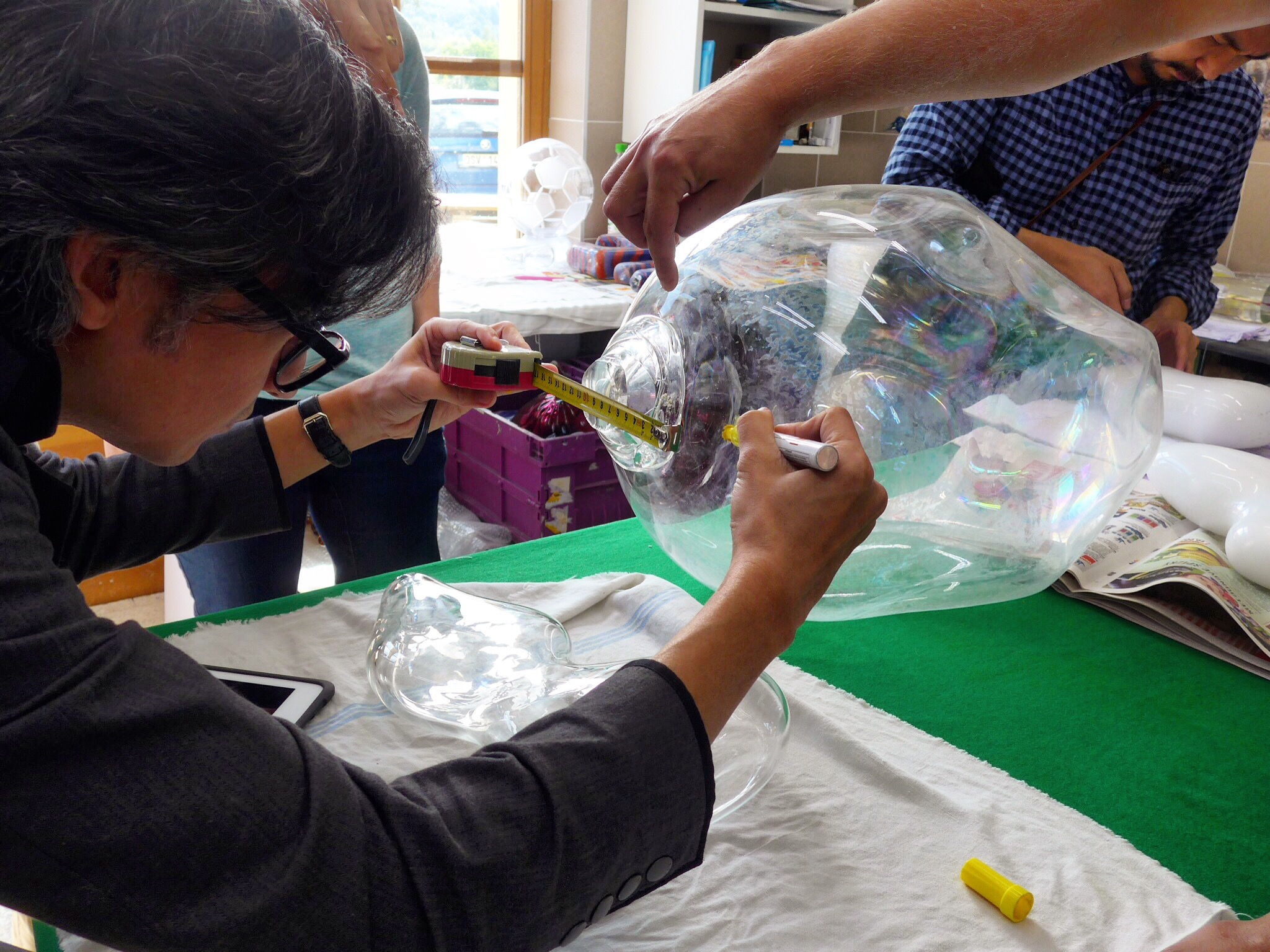 Spektacularis designers working at the glass studio in Prague. Pictured is a piece of blown glass.